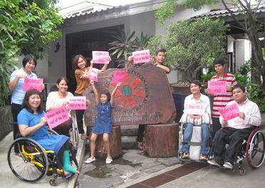 Staffs at  DPIAP office signs are fo  women equality campaign. Saowalak Thongkuay is seated at left.